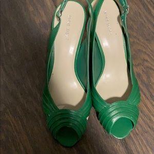 Never worn Nine West green heels.